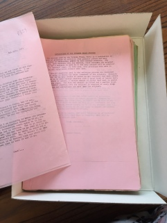 Bin filled with correspondence on pink carbon paper.